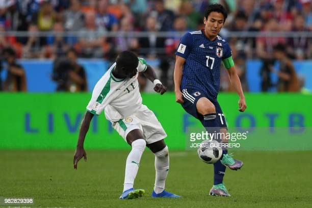 Senegal's midfielder Papa Alioune Ndiaye vies with Japan's midfielder Makoto Hasebe during the Russia 2018 World Cup Group H football match between...