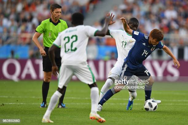 Senegal's midfielder Papa Alioune Ndiaye vies with Japan's midfielder Takashi Inui during the Russia 2018 World Cup Group H football match between...