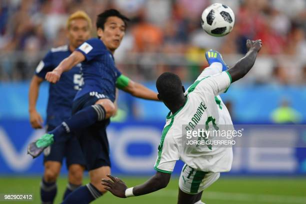 Senegal's midfielder Papa Alioune Ndiaye vies with Japan's midfielder Shinji Kagawa during the Russia 2018 World Cup Group H football match between...