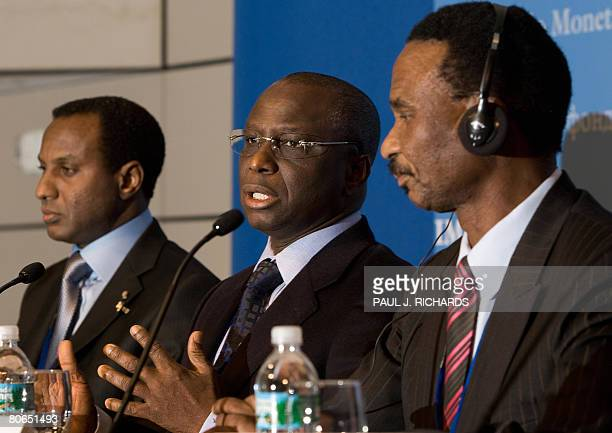 Senegal's Minister of Economy and Finance Abdoulaye Diop listens to a reporter's question as Nigerian Finance Minister Ali M Lamine Zeine and...