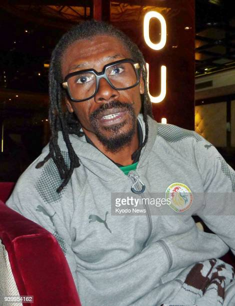 Senegal's national football coach Aliou Cisse speaks in an interview in Casablanca Morocco on March 24 2018 Senegal will play Poland Japan and...