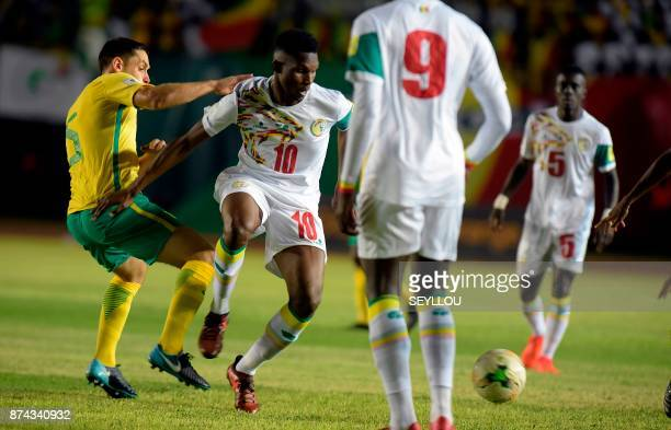 Senegal's Opa Ngette fights for the ball during the World Cup 2018 playoff football match between Senegal and South Africa at The Leopold Sedar...