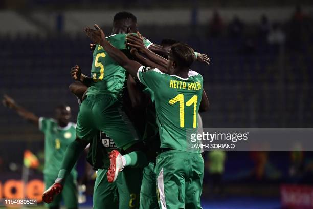 Senegal's players celebrate their goal during the 2019 Africa Cup of Nations quarter final football match between Senegal and Benin at the 30 June...