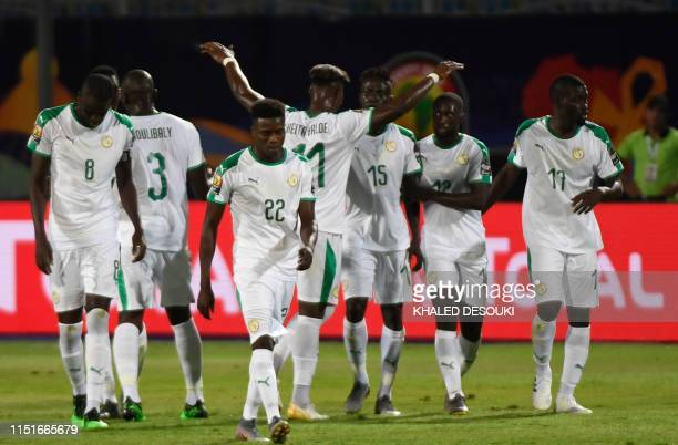 Senegal's players celebrate their second goal during the 2019 Africa Cup of Nations football match between Senegal and Tanzania at the 30 June...