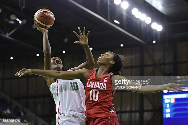 TOPSHOT Senegal's power forward Astou Traore goes to the basket despite Canada's shooting guard Nirra Fields during a Women's round Group B...