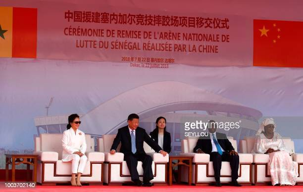 Senegal's President Macky Sall and his wife Marieme Faye Sall sit with China's President Xi Jinping and his wife Peng Liyuan during the inauguration...