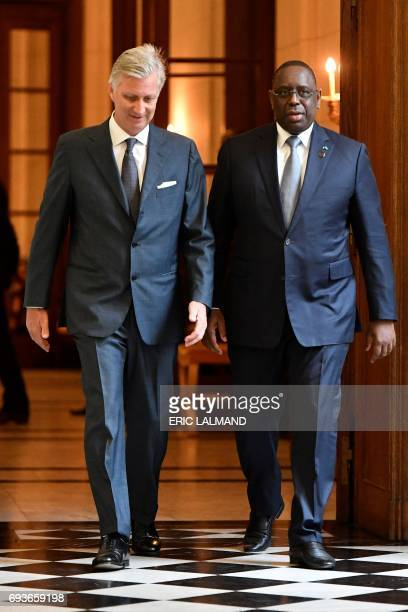 Senegal's president Macky Sall is welcomed by King Philippe Filip of Belgium prior to a meeting at the Royal Palace in Brussels on June 8 2017 / AFP...