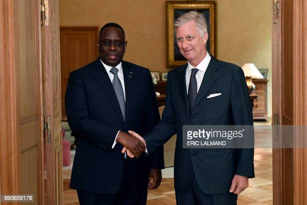 Senegal's president Macky Sall shakes hands with King Philippe Filip of Belgium prior to a meeting at the Royal Palace in Brussels on June 8 2017 /...