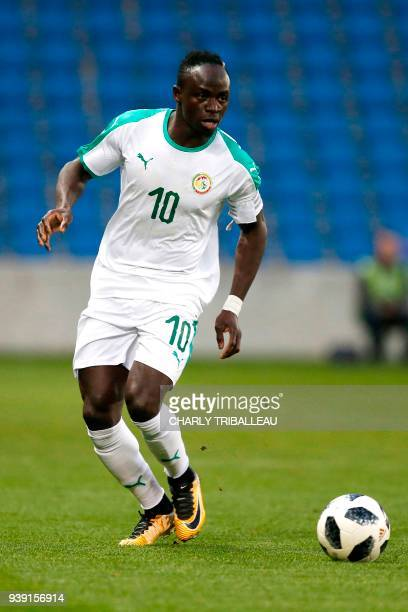 Senegal's Sadio Mane run with the ball during a friendly football match between Senegal and Bosnia at the Stadium Oceane in Le Havre northwestern...