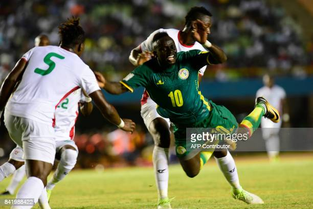 Senegal's Sadio Mane vies for the ball during the World Cup 2018 Africa qualifying football match between Senegal and Burkina Faso at the Stadium...