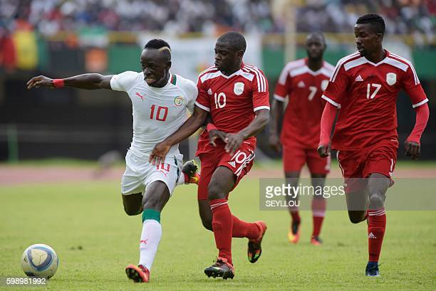 Senegal's Sadio Mane vies with Namibia's Wangu Batista Gom during the 2017 African Cup of Nations qualification football match between Senegal and...