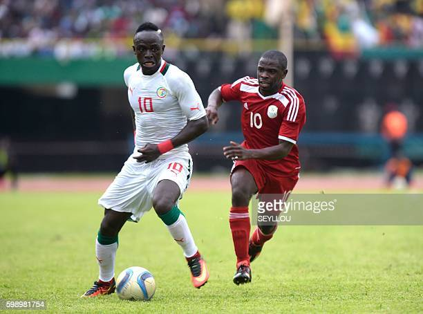 Senegal's Sadio Mane vies with Namibia's Wangu BatistaGome during the 2017 African Cup of Nations qualification football match between Senegal and...