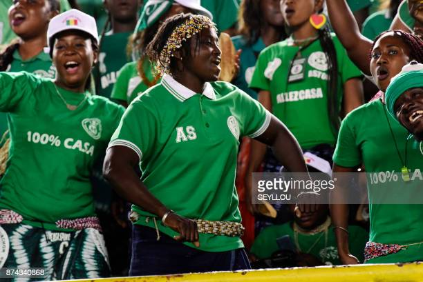 Senegal's supporters cheer their team during the World Cup 2018 playoff football match between Senegal and South Africa at The Leopold Sedar Senghor...