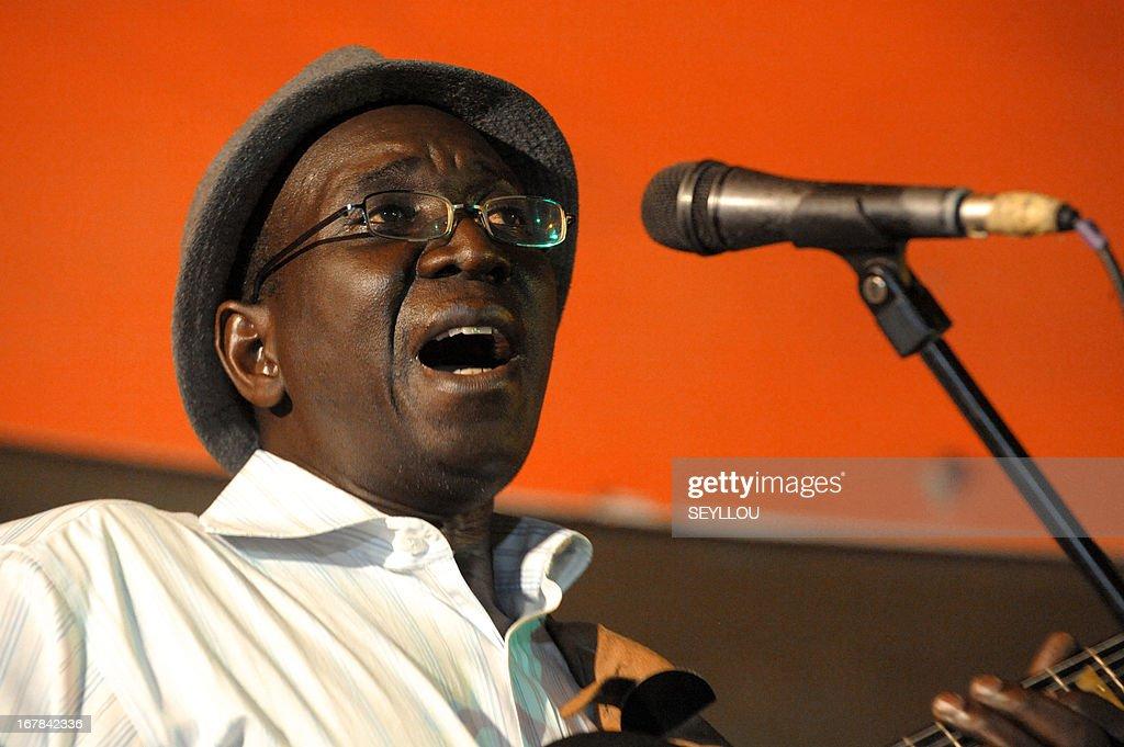 Senegalse jazzman Vieux Mac Faye sings on April 29, 2013 during celebrations for the International Jazz Day in Dakar.