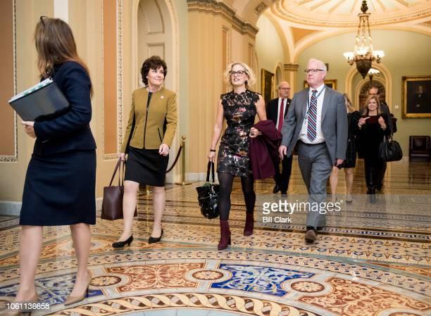 Senelect Rep Jacky Rosen DNev left and Senelect Rep Kyrsten Sinema DAriz walk through the Ohio Clock Corridor on their way to meet with Senate...