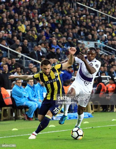 Sener Ozbayrakli of Fenerbahce in action against Aminu Umar of Osmanlispor during the Turkish Super Lig football match between Fenerbahce and...