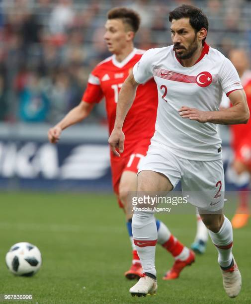 Sener Ozbayrakli of Turkey in action against Aleksandr Golovin of Russia during an international friendly match between Russia and Turkey in Moscow...