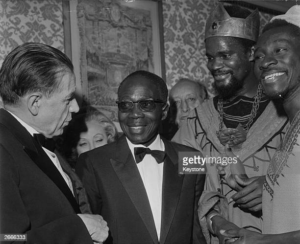 Sengalese president, poet and intellectual, Leopold Senghor introducing cast members of a production of 'Macbeth' to Edmond Michelet, Senegal's...