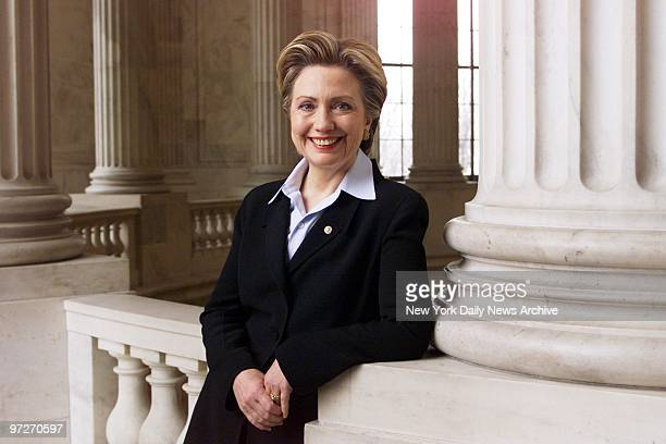 Sen.Hillary Rodham Clinton smiles for her official portrait in the rotunda of the Russell Senate Office Building.