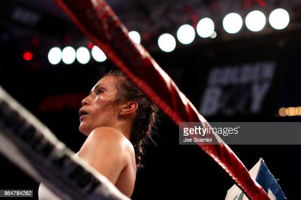 Seniesa Estrada watches Amarilis Adorno get medical attention in the second round during the Flyweight Fight at StubHub Center on May 4 2018 in...