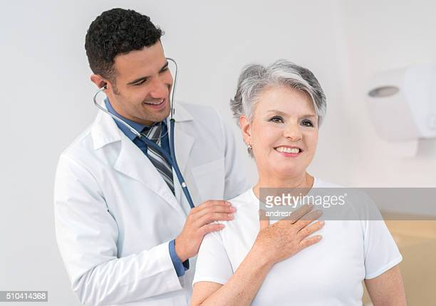 senior adult at the doctor - cardiologist stock pictures, royalty-free photos & images