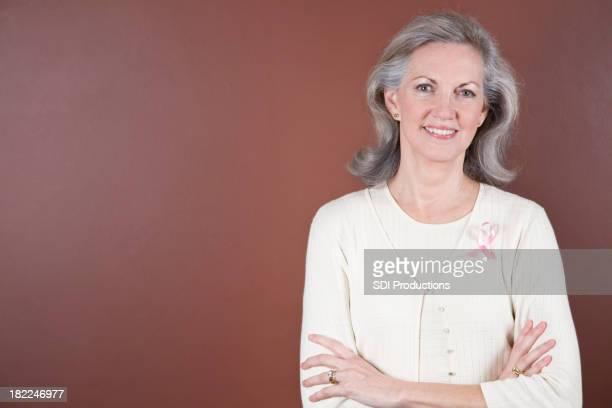 Senior Adult Breast Cancer Survivor with Maroon Copy Space