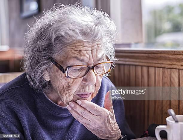 Senior Adult Dementia Woman Confused by Restaurant Breakfast Menu