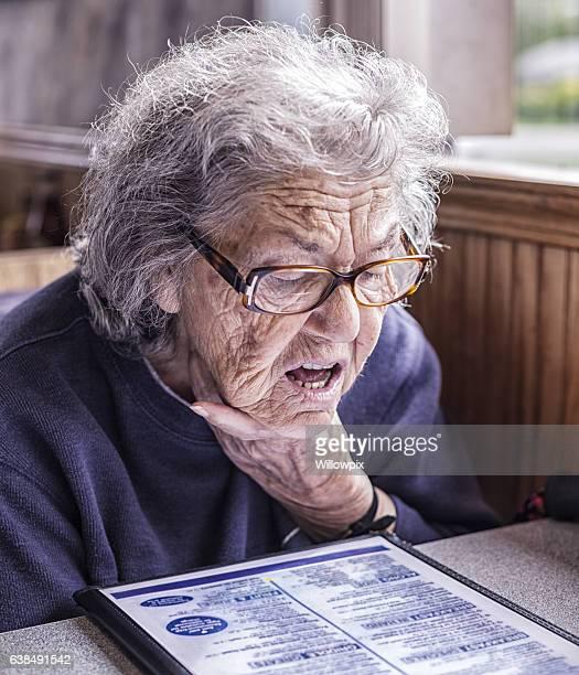 Senior Adult Dementia Woman Reading Restaurant Breakfast Menu
