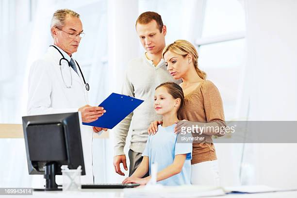 Senior adult doctor with his patients