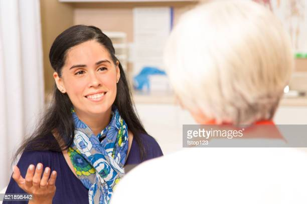 senior adult female doctor, therapist and patient in office, clinic. - women's issues stock photos and pictures