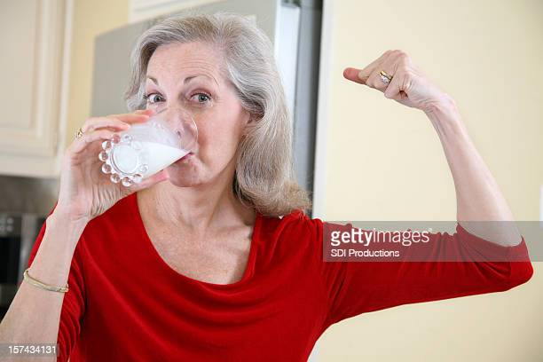 Senior Adult Female Staying Strong by Drinking Milk