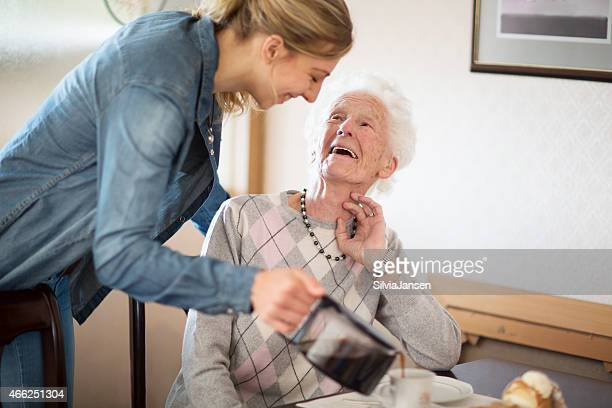 senior adult getting care and assistance - zorg stockfoto's en -beelden