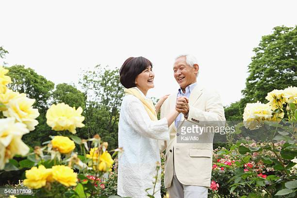 Senior adult Japanese couple in a park