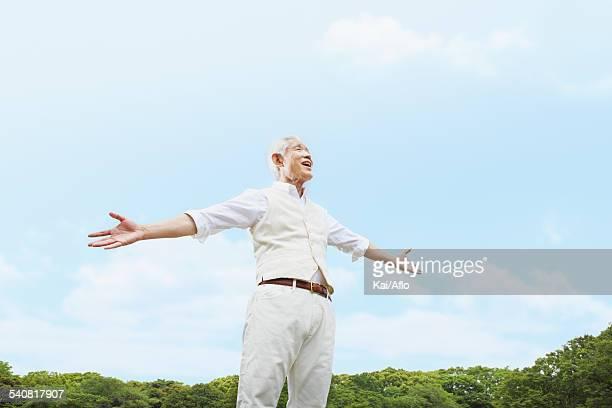 Senior adult Japanese man in a park