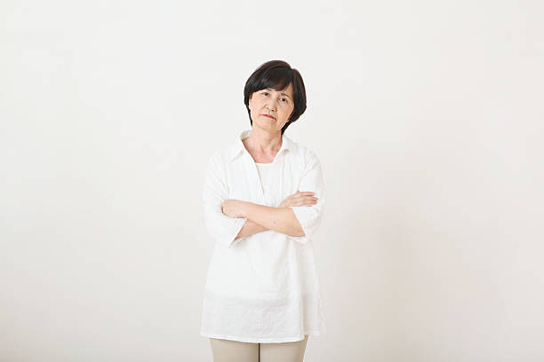 senior adult japanese woman against white wall - angry old asian lady stock pictures, royalty-free photos & images