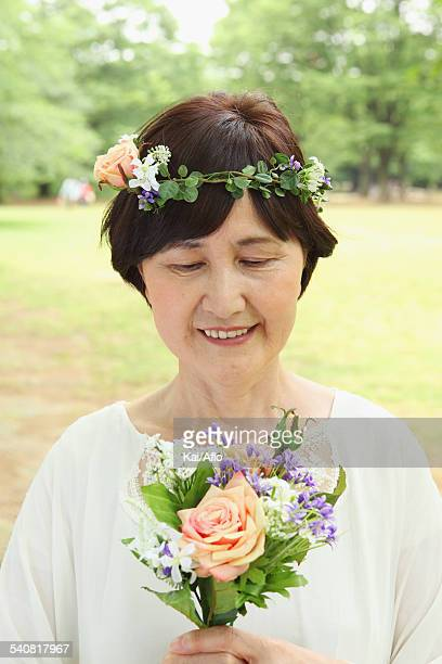 Senior adult Japanese woman in a park