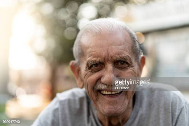 senior adult male laughing portrait; he is 89 years old - senior men stock pictures, royalty-free photos & images