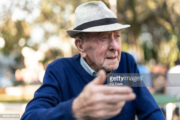 senior adult male talking; he is 91 years old - 90 plus years stock pictures, royalty-free photos & images