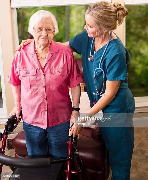 Senior adult patient with home healthcare nurse. House call. Walker.