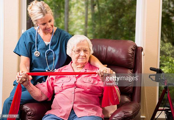 Senior adult patient with home healthcare nurse. Physical therapy.
