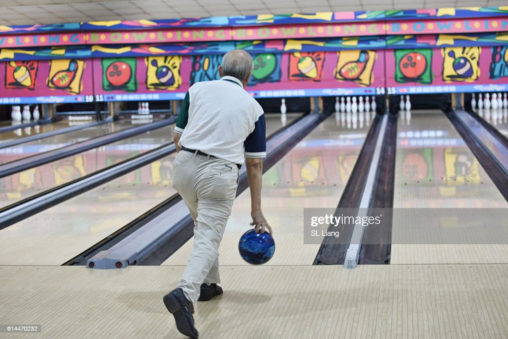 senior adult playing bowling : Stock Photo
