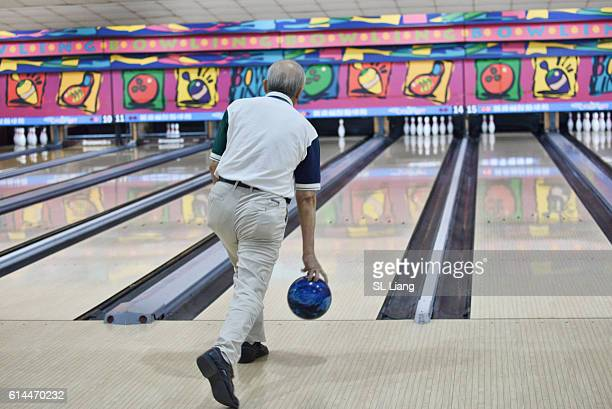 senior adult playing bowling