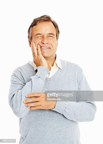 Alter Erwachsener leiden Zahnschmerz gegen Weiß