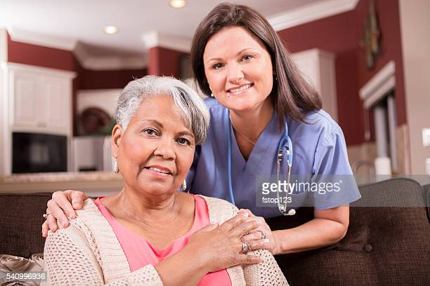 Senior adult with home healthcare nurse, caregiver at home.