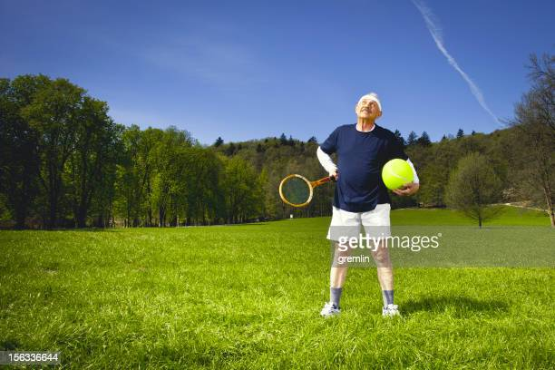 senior adult with tennis racket in the park - man with big balls stock photos and pictures