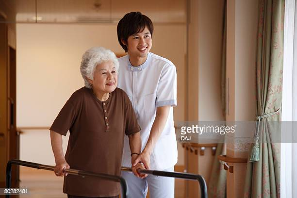 A Senior Adult Woman and A Young Care Worker Undergoing Rehabilitation