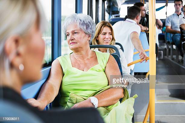 Senior adult woman commuting by bus