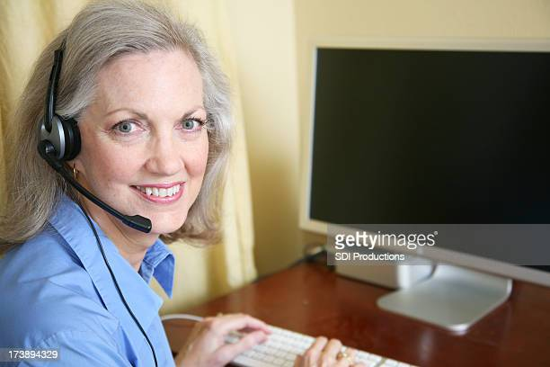 Senior Adult Woman Customer Service Representative Working From Home Office