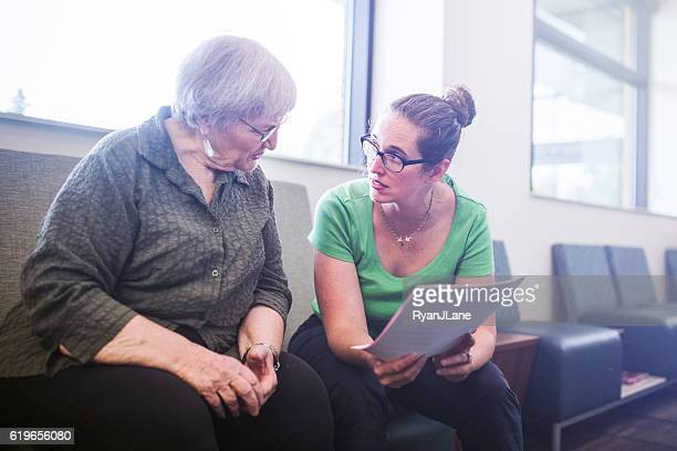 senior adult woman filling out paperwork - form filling stock pictures, royalty-free photos & images