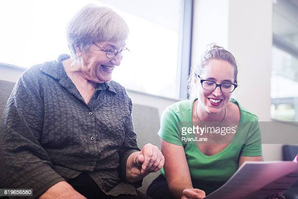 Senior Adult Woman Filling Out Paperwork